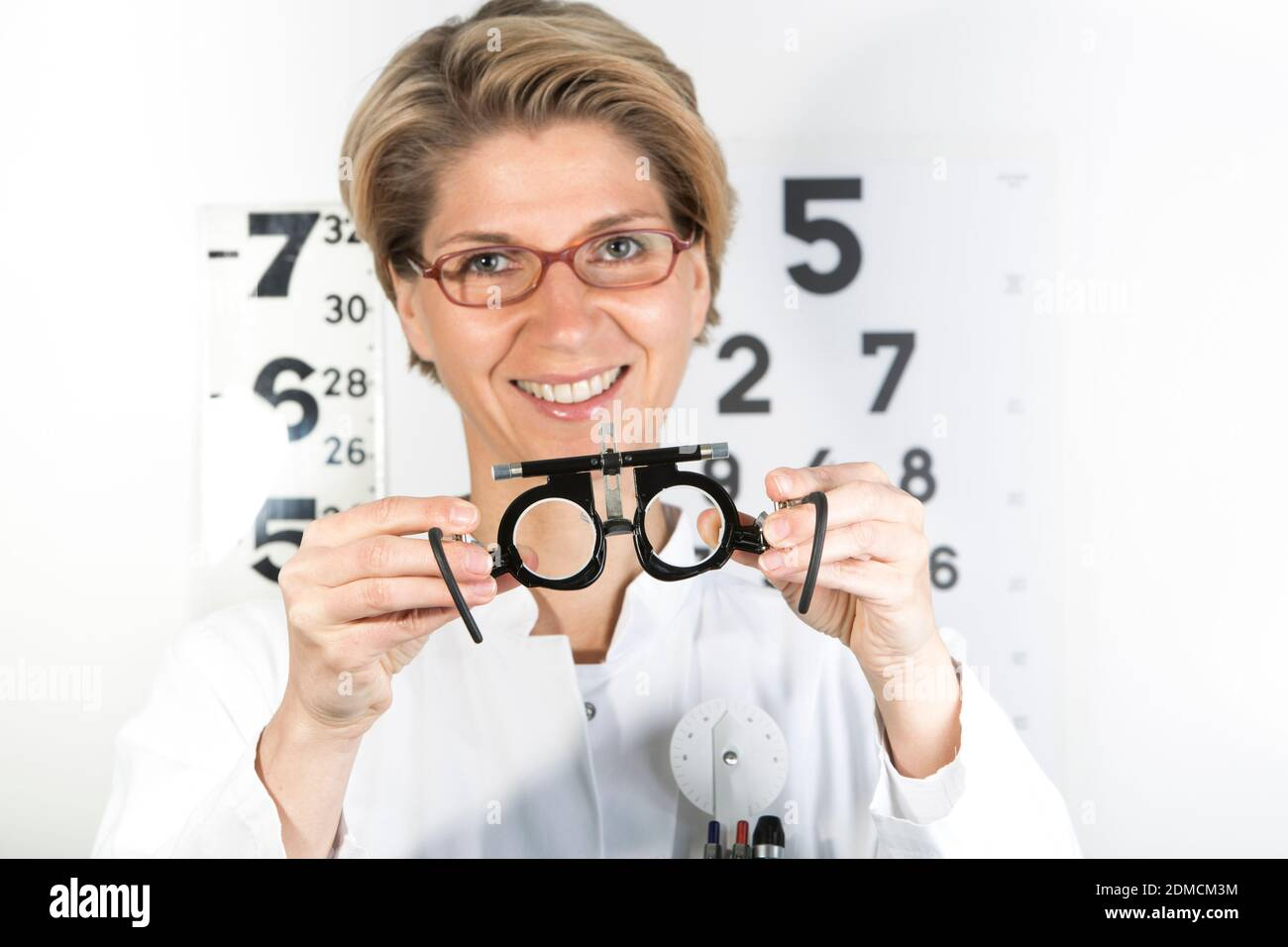Young eye doctor W34 with testing frame on the eye chart, Germany, Europe Stock Photo