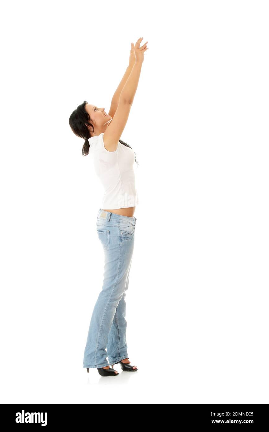 Woman trying to reach something with her hand Stock Photo