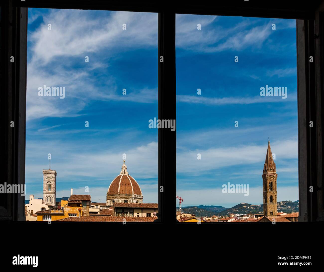 Beautiful panoramic rooftop view of Giotto's Campanile, the Florence Cathedral's dome with cupola and the bell tower of the Badia Fiorentina church,... Stock Photo