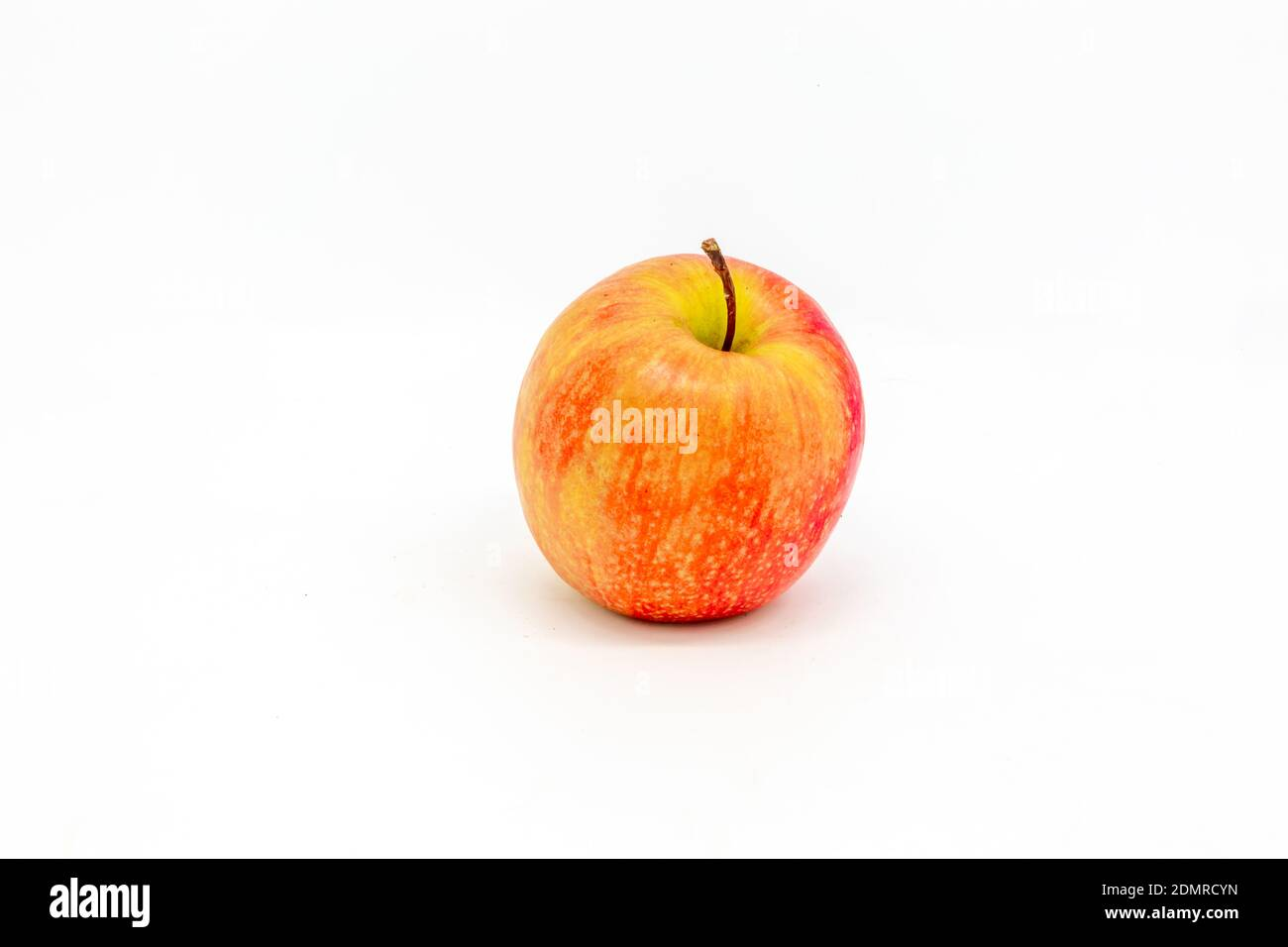 A studio shot of a whole apple, with a white background Stock Photo
