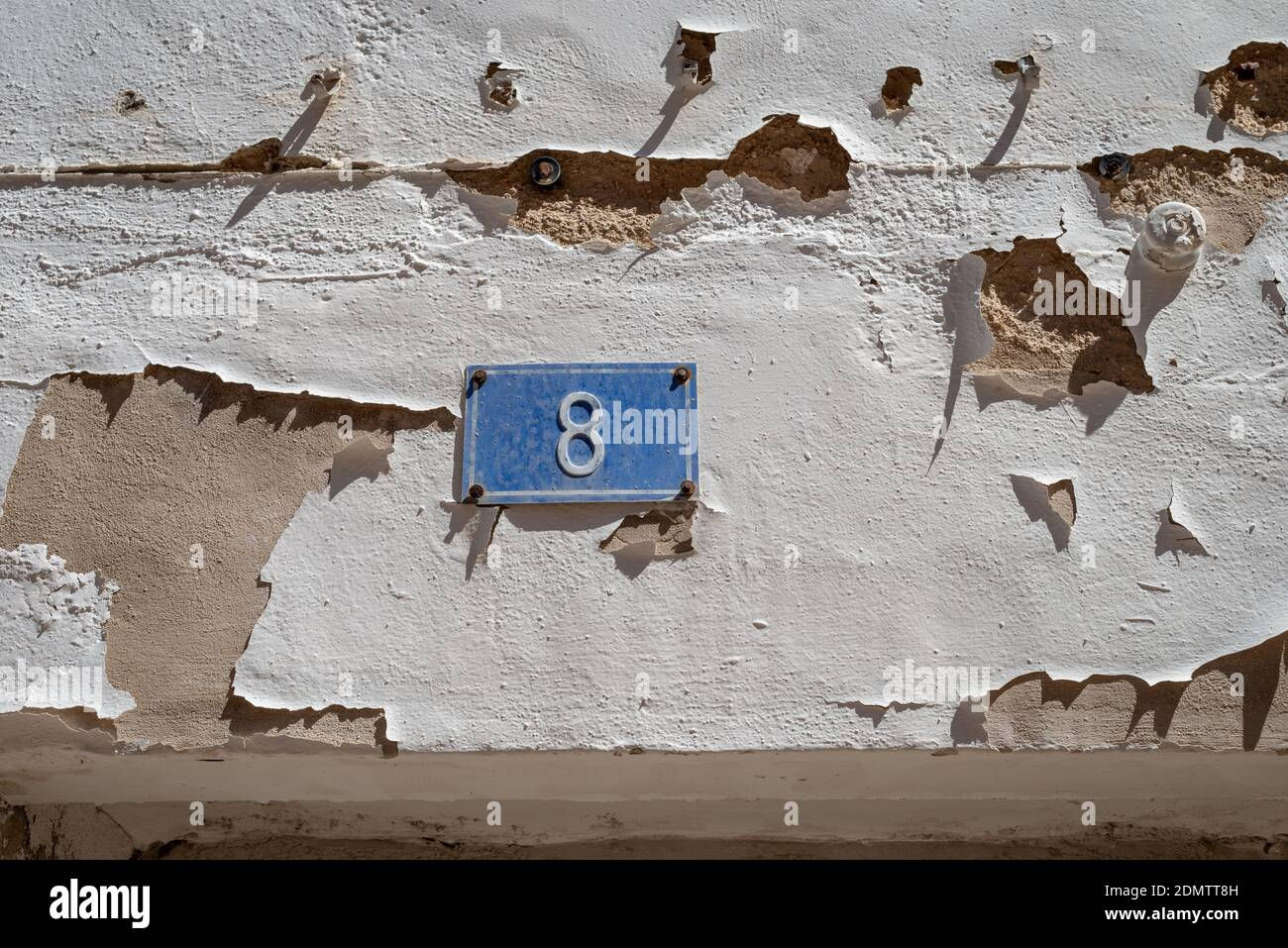 A plaque displaying the number eight outside a house in Denia, Spain. Stock Photo