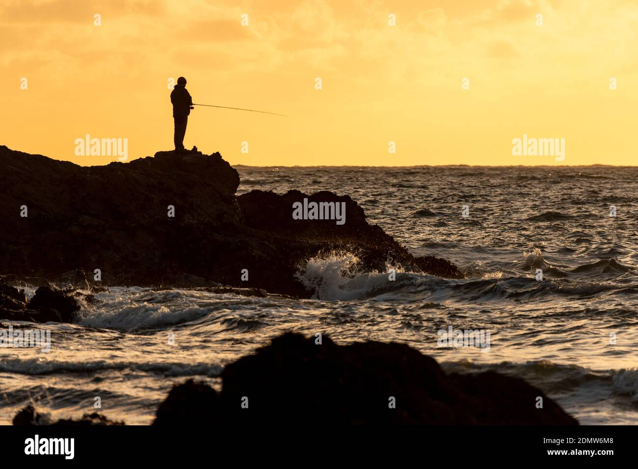 Sea angler at Porth Dafarch, Anglesey, North Wales Stock Photo