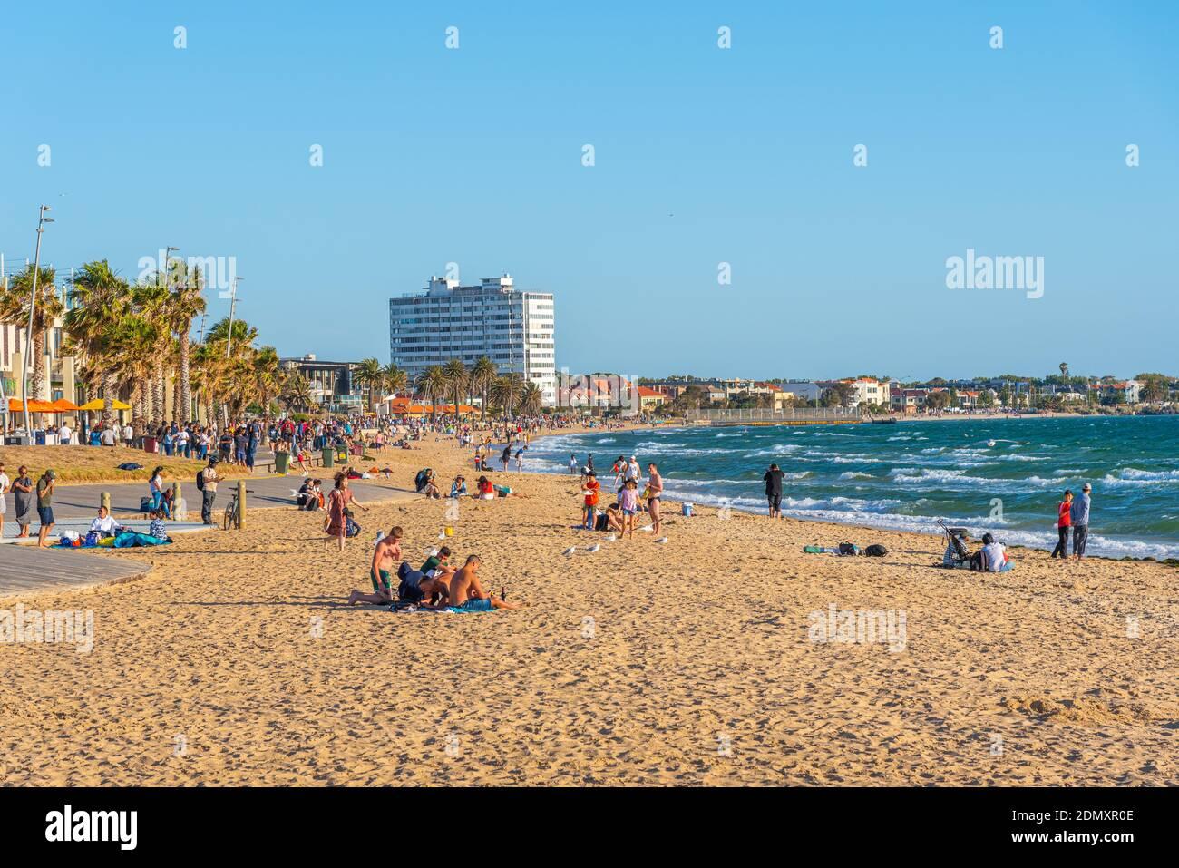 MELBOURNE, AUSTRALIA, JANUARY 1, 2020: People are enjoying a sunny day on a beach at St. Kilda, Australia Stock Photo