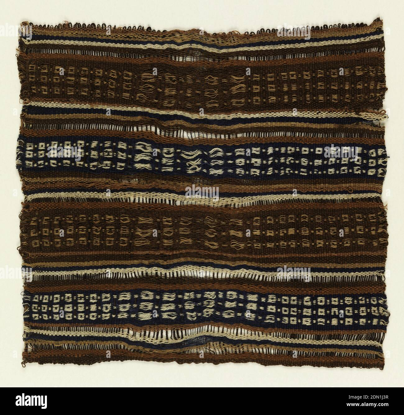 Fragment, Medium: cotton, wool Technique: warp-faced plain weave patterned by warp floats and stripes, Horizontal bands wide and narrow. Wide bands are warp-patterned in a light color on either blue or brown background. Other colors are tan and dark red. Fragment probably from a bag., Peru, 1000–1450, woven textiles, Fragment Stock Photo