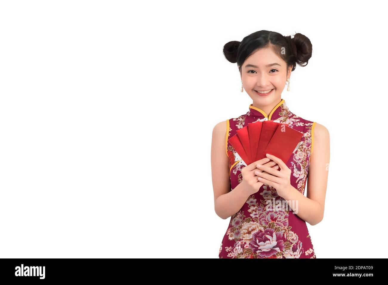 Portrait Of Beautiful Woman Wearing Chinese Dress Holding Envelopes Against White Background Stock Photo
