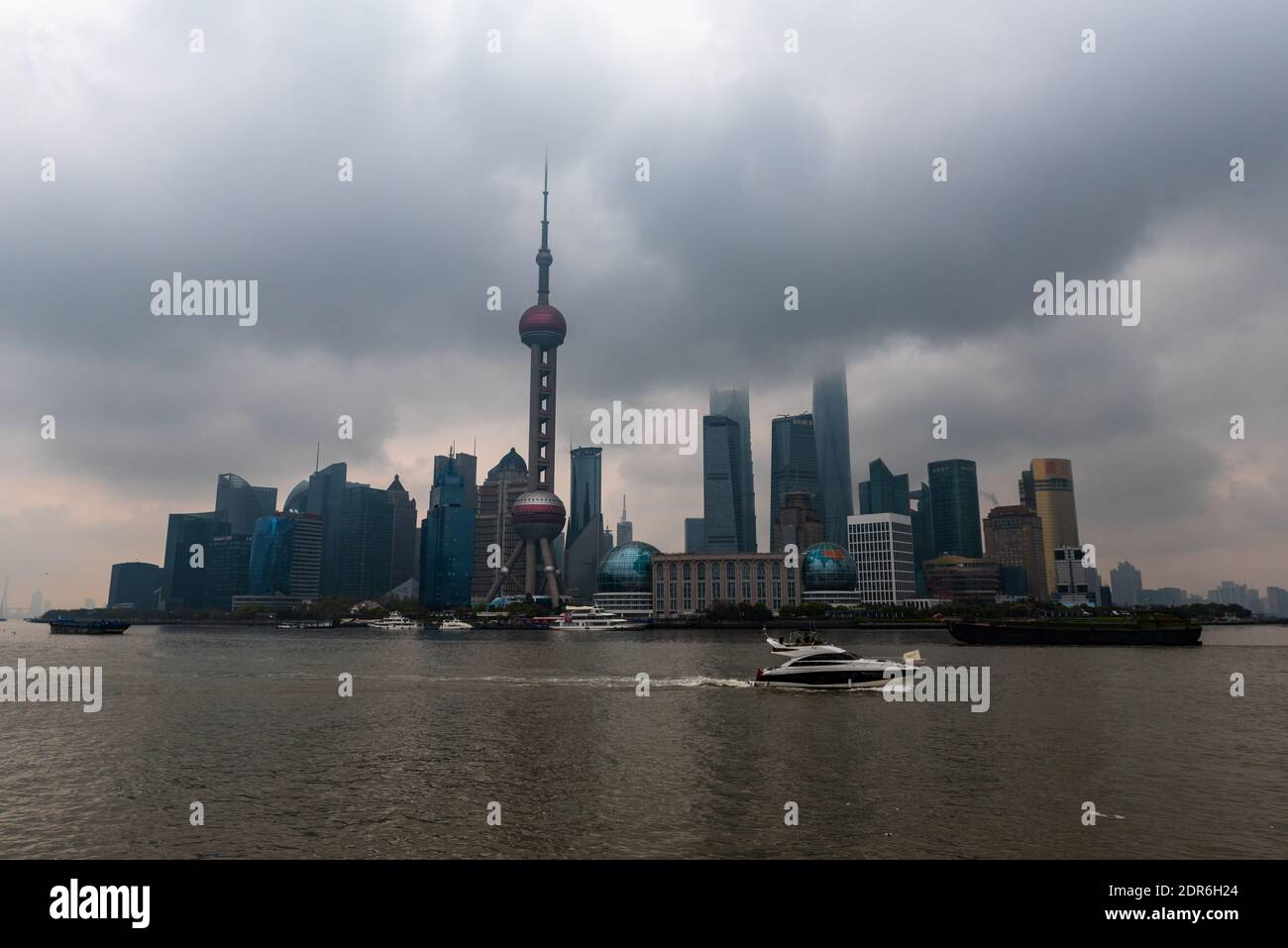 Shanghai, China -- March 30, 2016. A wide angle photo of the Shanghai skyline featuring the Oriental Pearl Tower on a foggy morning. Stock Photo
