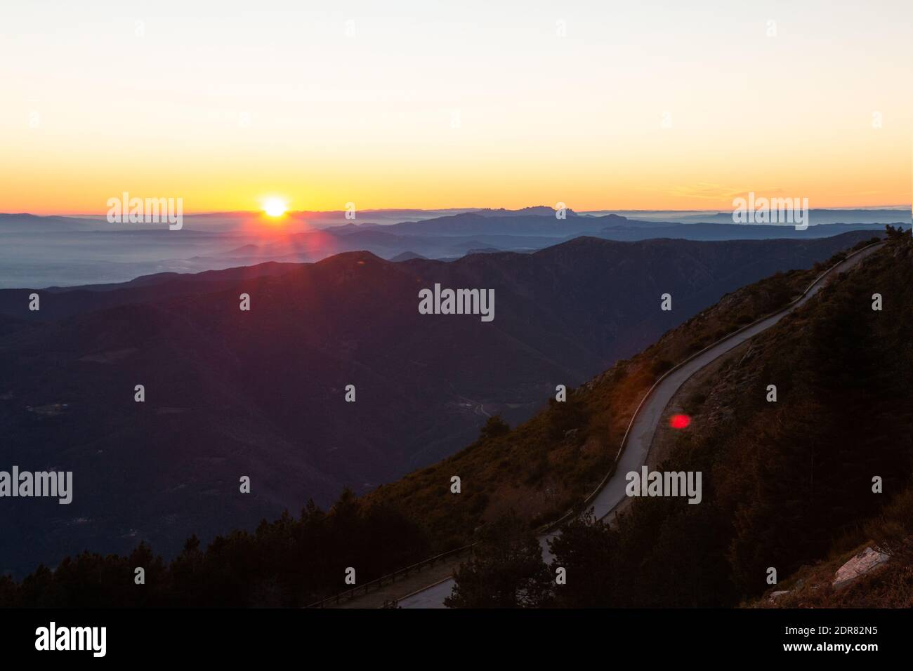 Mountain road with spectacular views of different mountain ranges with sunset or sunrise. Montseny, Montserrat, Turo de l'Home, Barcelona, Catalonia, Stock Photo