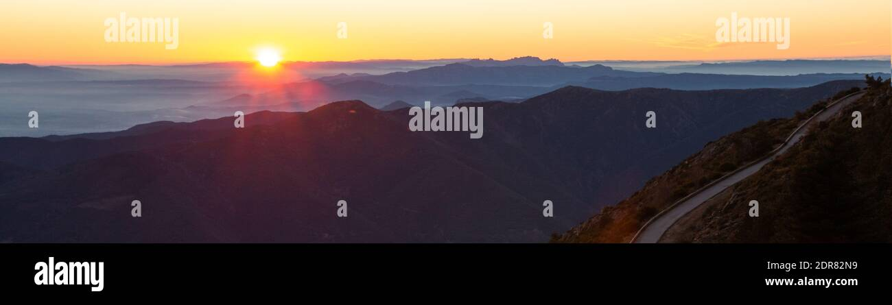 Mountain road with spectacular views of mountain ranges with sunset or sunrise, panoramic view. Montseny, Montserrat, Turo de l'Home, Barcelona, Catal Stock Photo