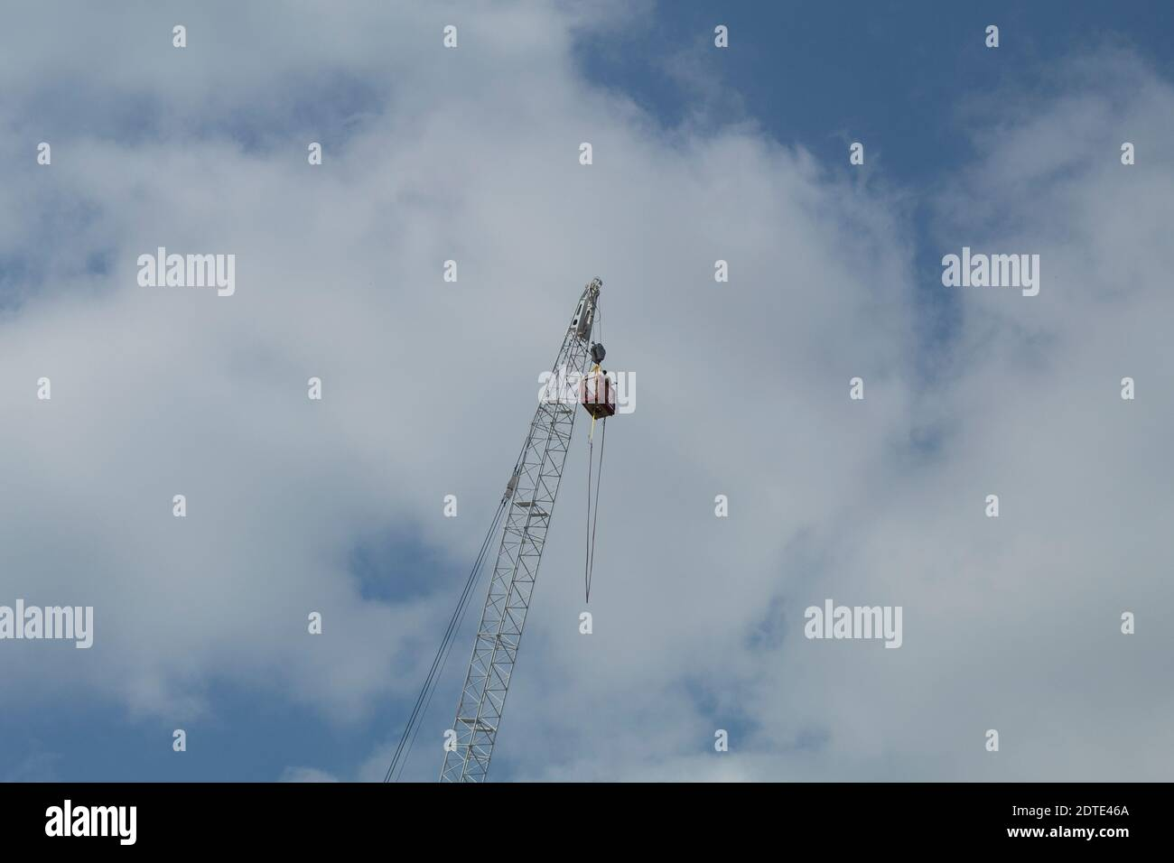 Jump from a height of a tower crane. Jumping from a tower crane. Extreme trick with instructor Stock Photo