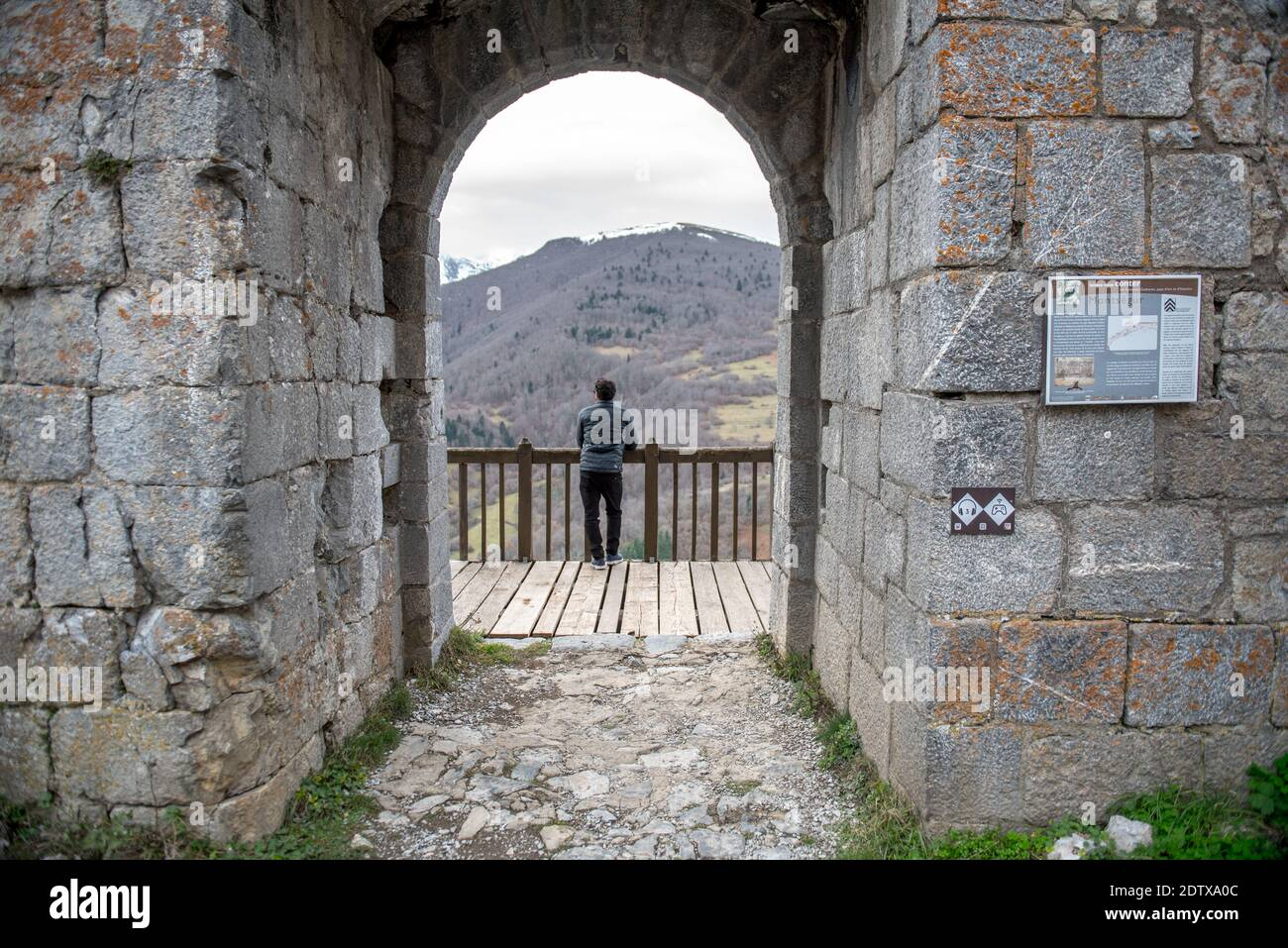 Montsegur, Aringe, France: 2020 from December 20: Men in Cathar castle of Montsegur in Ariege, Occitanie in south of France in winter 2020 Stock Photo