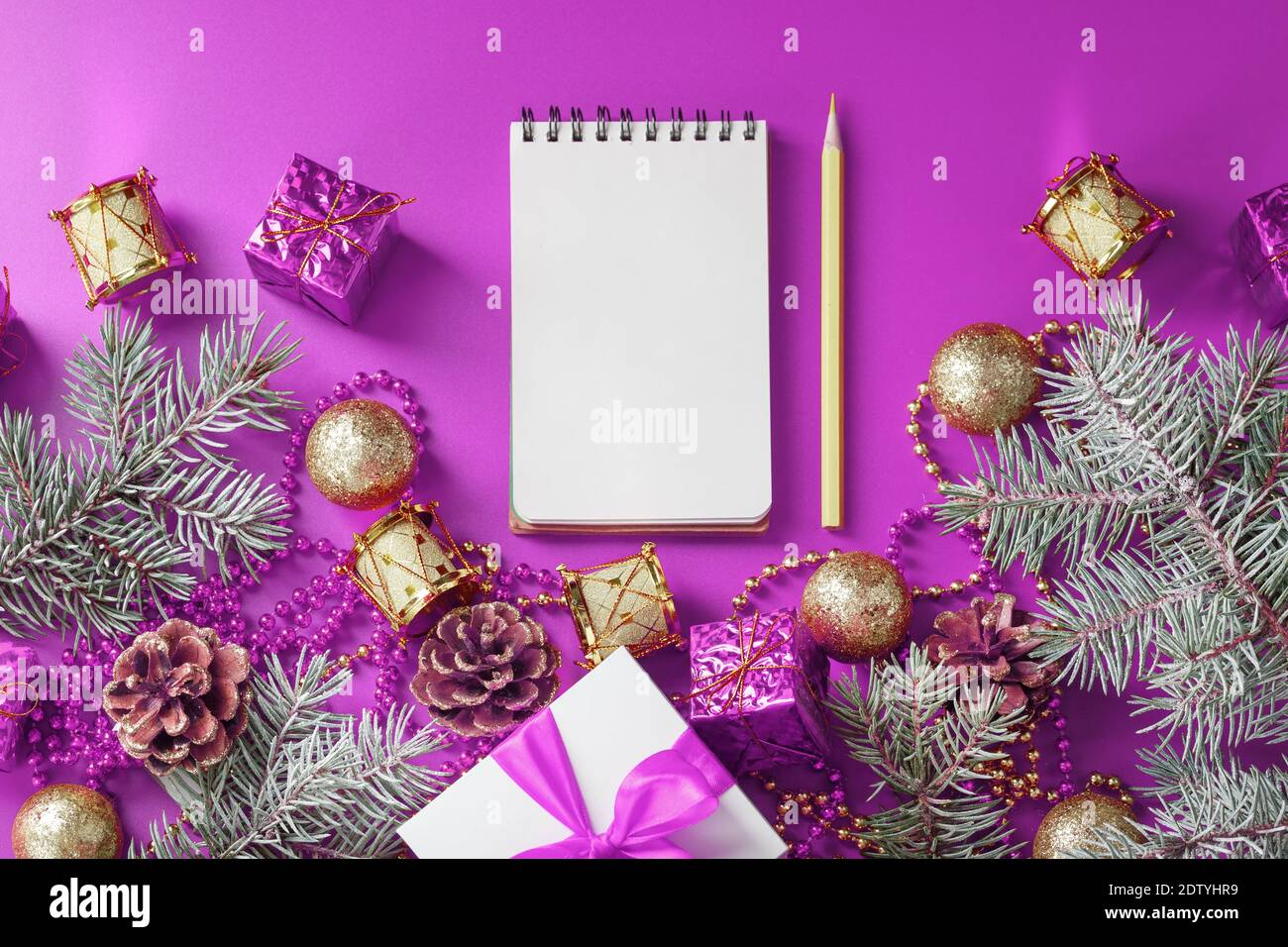 Closed For Christmas 2021 Purple Ornements Pics Clean White Notepad With Pencil Around Christmas Decorations On Purple Background Planning Wish List And Resolution 2021 The View From The Top Stock Photo Alamy