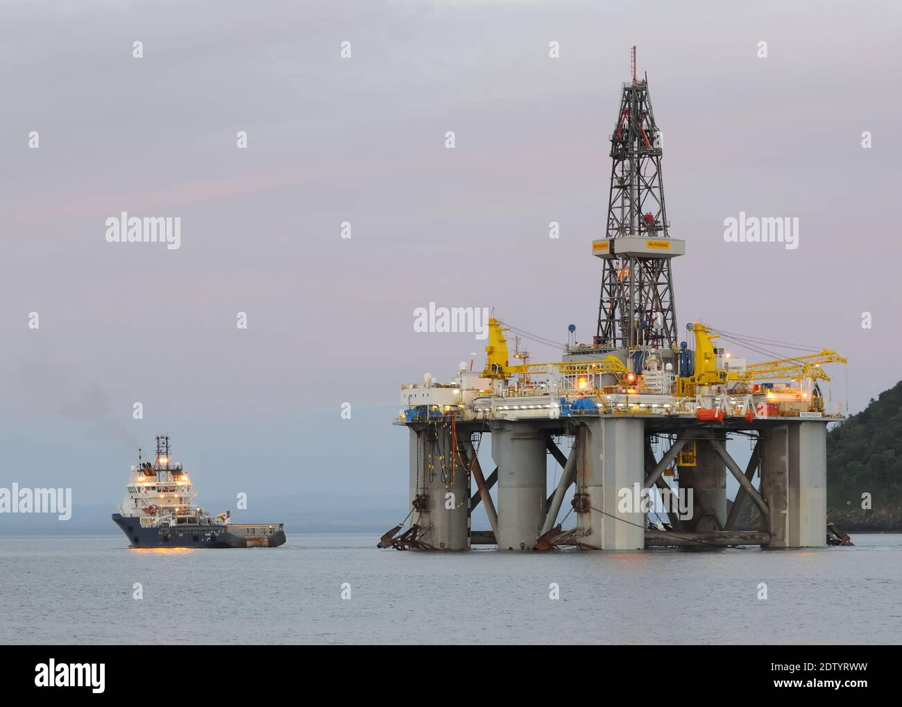 The WilPhoenix is a 3rd-Generation, Enhanced Pacesetter, Harsh-Environment, Mid-Water, Semi-Submersible Drilling Rig being towed from Cromarty Firth Stock Photo