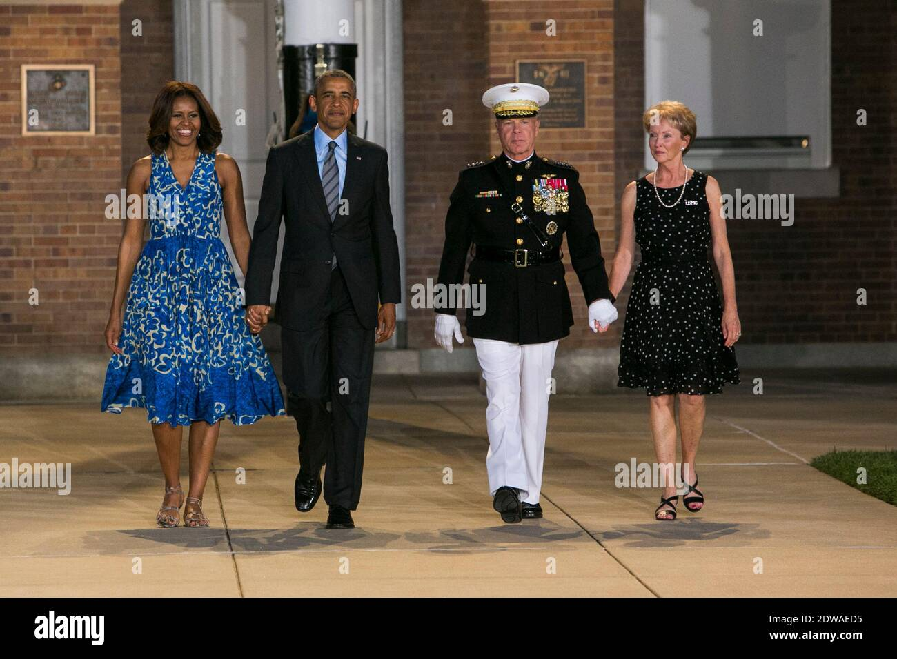 President Barack Obama, left, First Lady Michelle Obama, center left, Marine Corps Commandant General James F. Amos, center right, and his wife Bonnie, right, arrive to the Marine Barracks Evening Parade in Washington, DC, USA., on June 27, 2014. Photo by Kristoffer Tripplaar/Pool/ABACAPRESS.COM Stock Photo