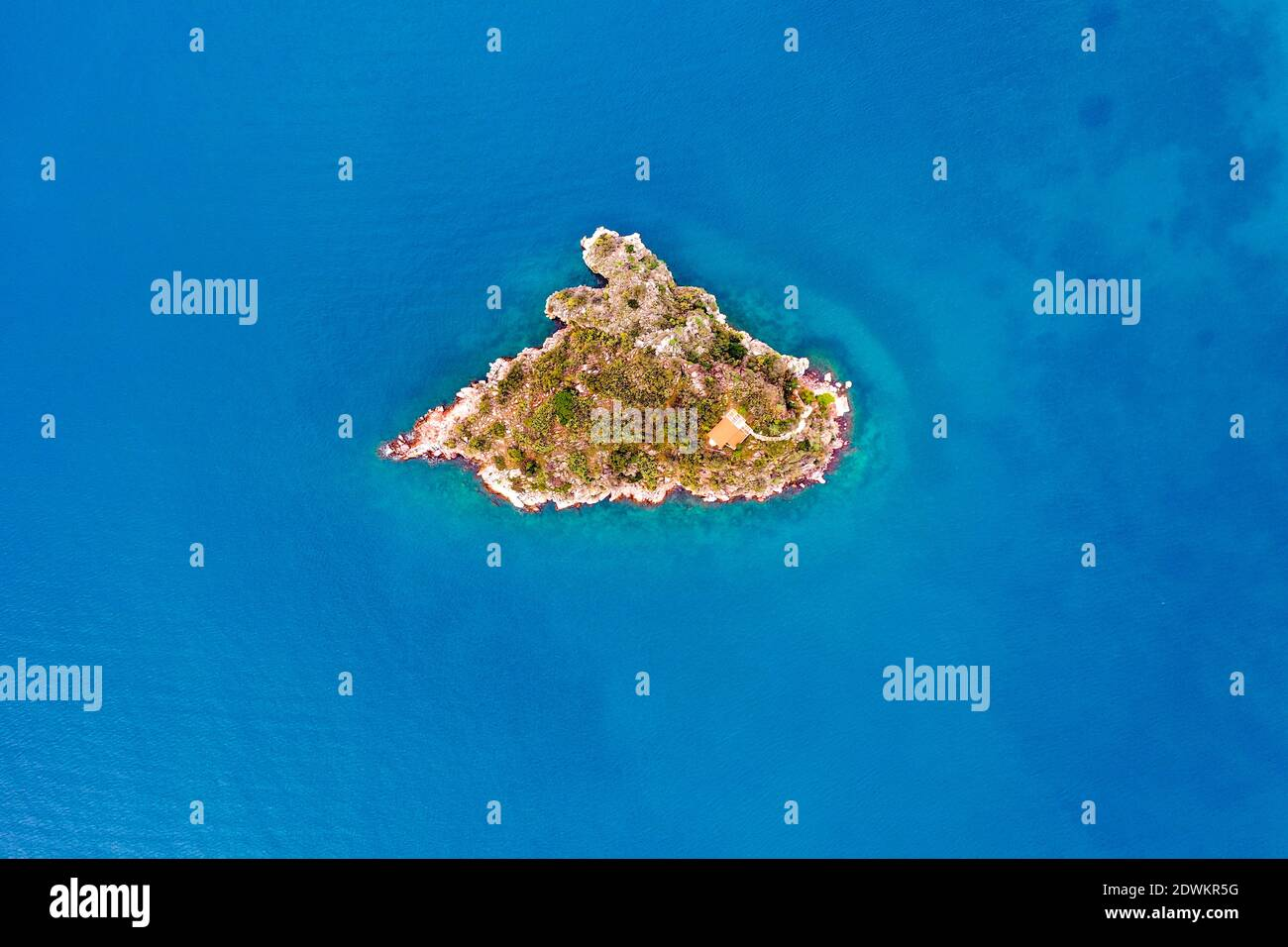 Top down aerial view of small rock island Stock Photo