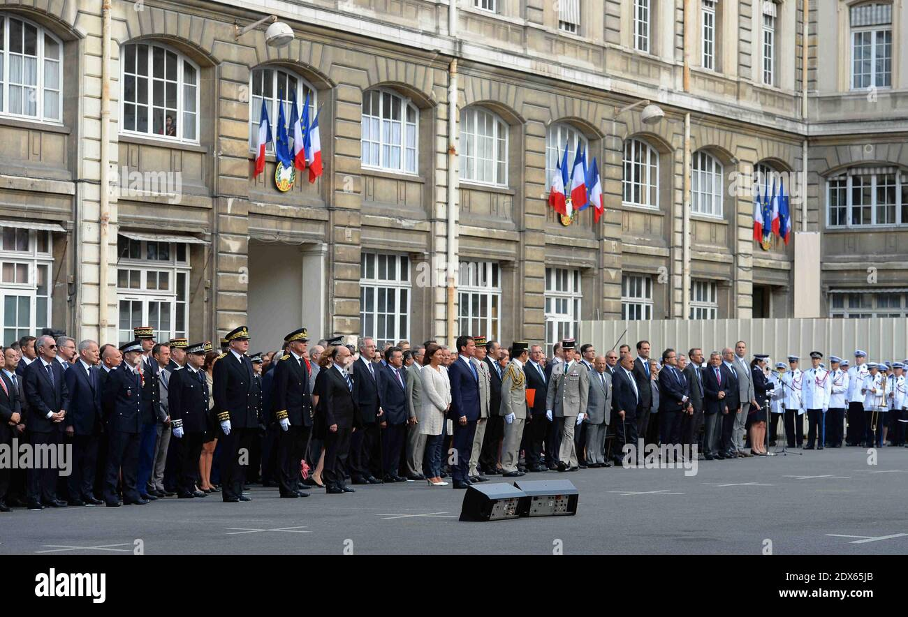 """French Prime minister Manuel Valls, Paris' mayor Anne Hidalgo, French Interior minister Bernard Cazeneuve, Nathalie Kosciusko-Morizet taking part in a tribute ceremony commemorating the 70th anniversary of the uprising of the Paris' prefecture policemen at the headquarters of the Prefecture of Police of Paris, on August 19, 2014. Paris will start on August 19, 2014 a week of celebrations for the 70th anniversary of its liberation in 1944 during the World War II, with an ultimate highlight during the evening on August 25: a light show ending with a """"popular bal"""" in front of the Town hall. Photo Stock Photo"""