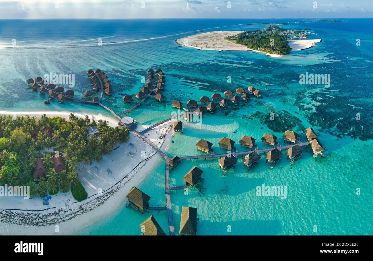 Maldives, Kaafu Atoll, Aerial view of tropical tourist resort on Huraa island Stock Photo