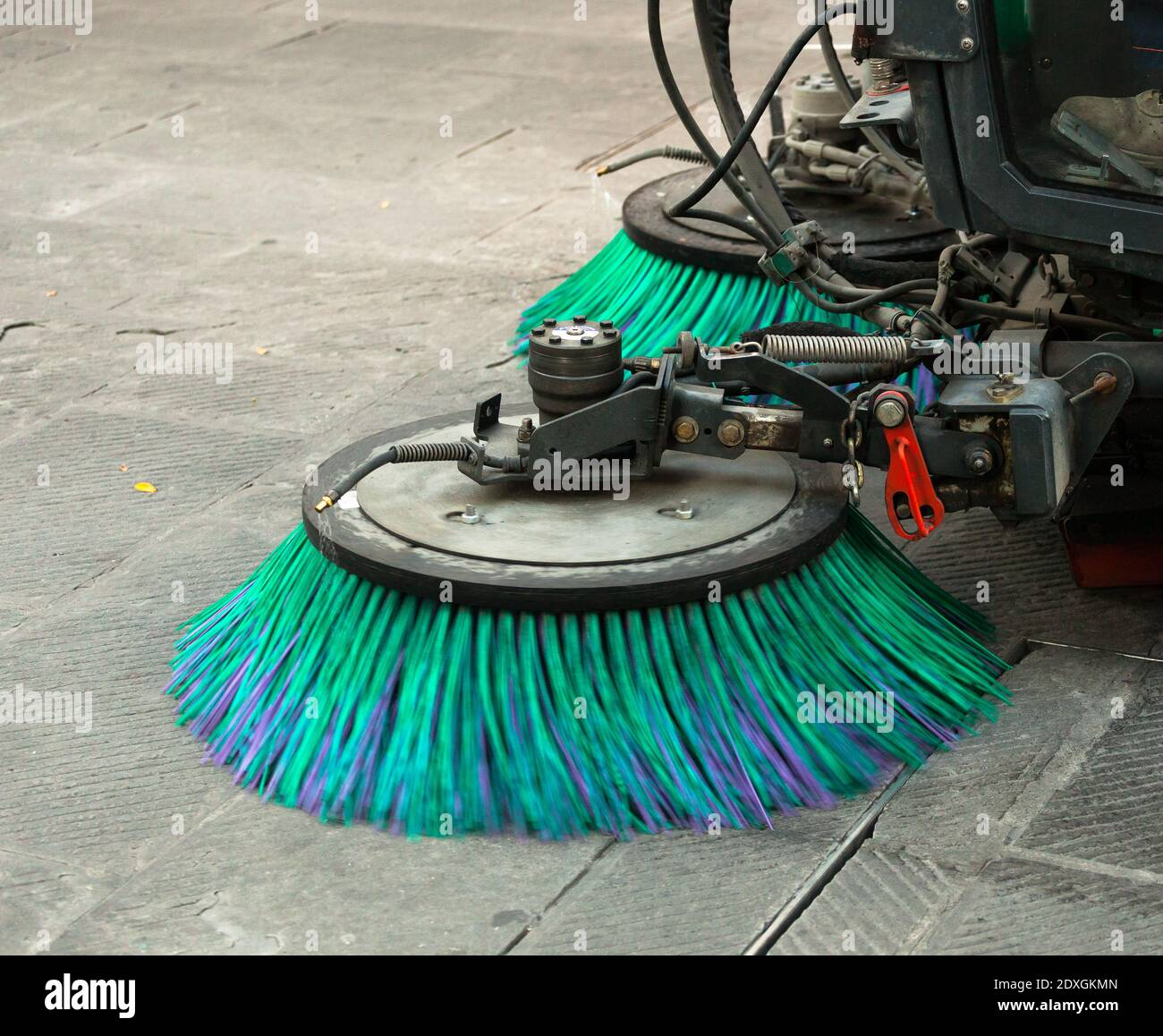 A street sweeper machine cleaning the streets. Stock Photo