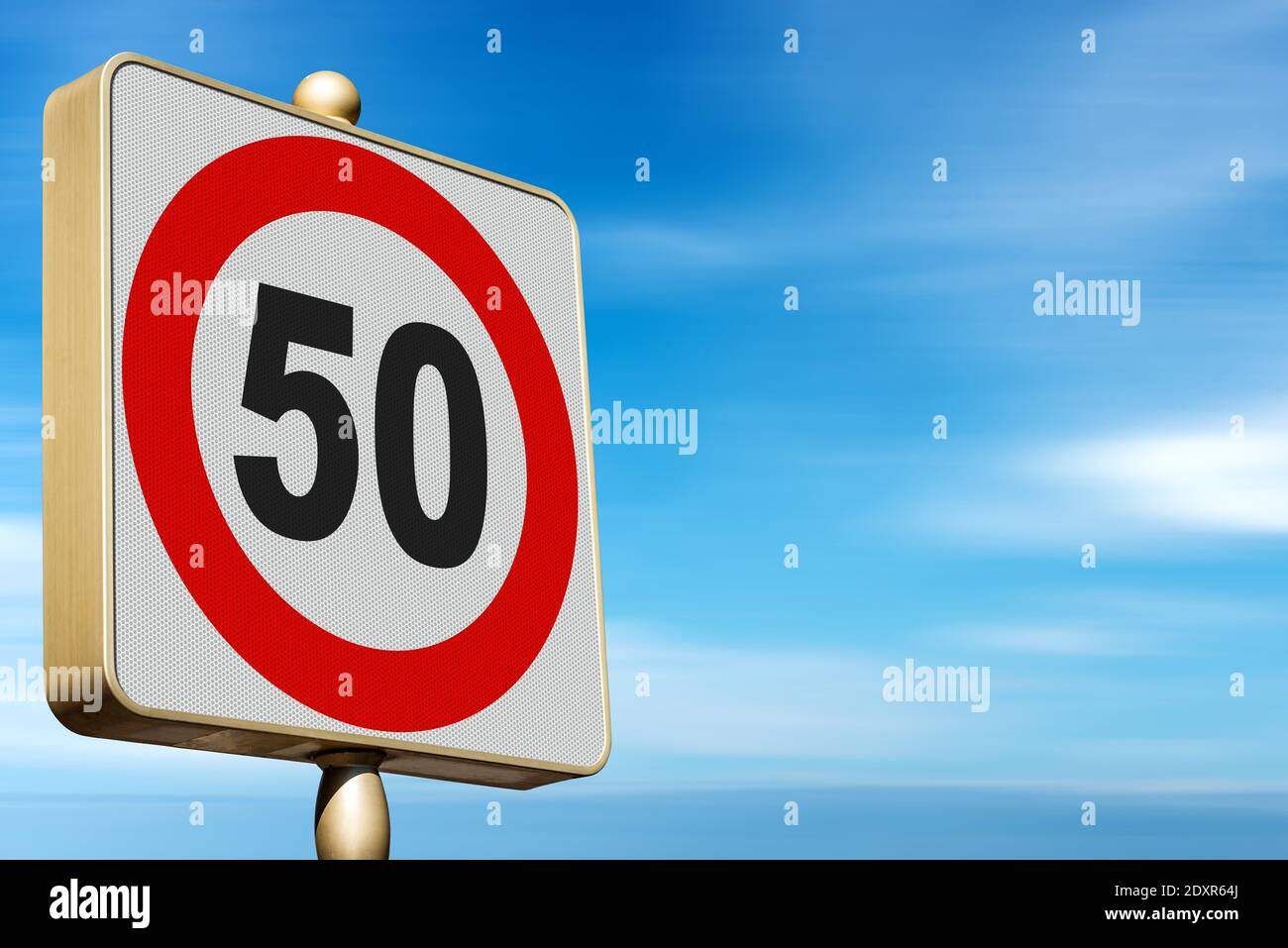 Closeup of a modern Road Sign Speed Limit 50 Kmh (kilometers per hour), on blue sky with clouds and copy space. Stock Photo