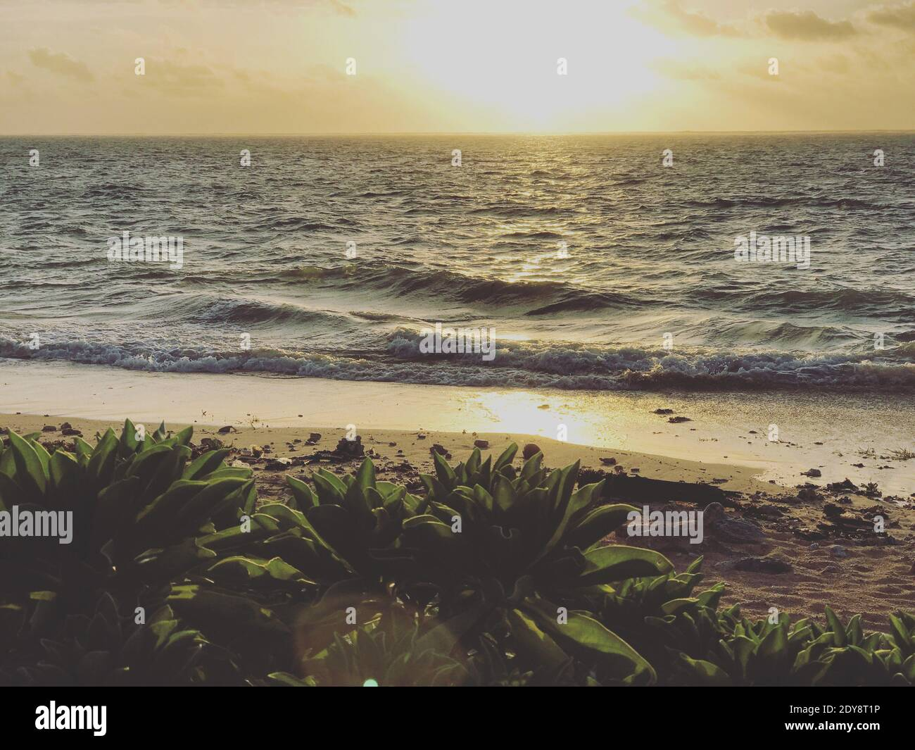 Scenic View Of Sea Against Sky During Sunset Stock Photo