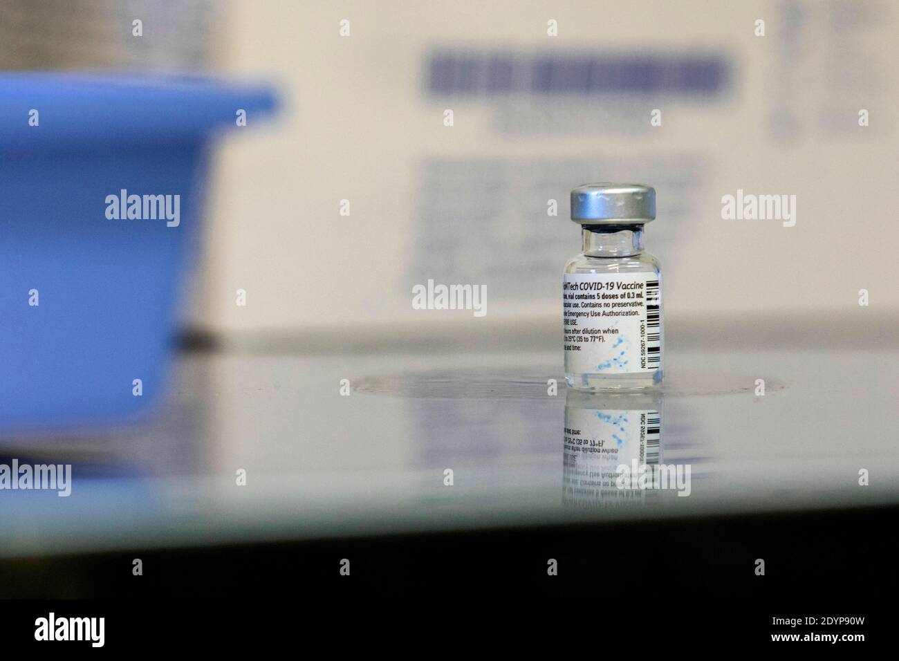 A vial of the vaccine produced by Pfizer / BioNTech at the Santa Maria hospital.Vaccination plans against Covid19 have started across Europe and health professionals at Santa Maria hospital are the first to receive the vaccine. Stock Photo