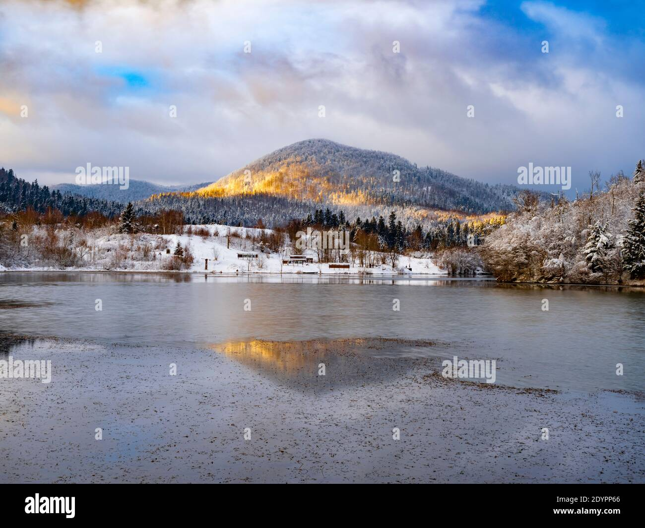 Winter show landscape scenery scenic panorama sunset patch of warm light passing through clouds lake Mrzla vodica in Croatia Europe Stock Photo
