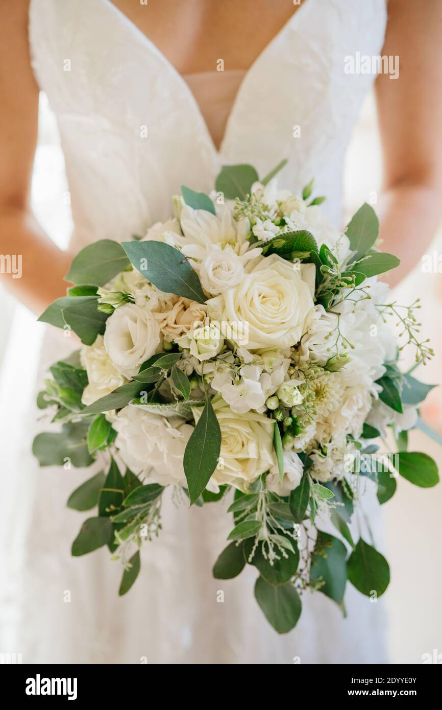 Traditional Light Pink And White Roses Arranged In A Bridal Bouquet Romantic Celebration Decoration Bride In Lace Wedding Dress Holding An Elegant Bou Stock Photo Alamy