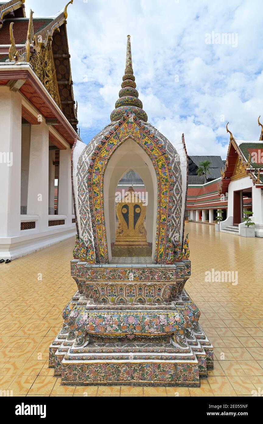 One of the eight cardinal boundary or sima (sema) stones at the ordination hall (ubosot) at Wat Saket, a Buddhist monastery in Bangkok, Thailand Stock Photo