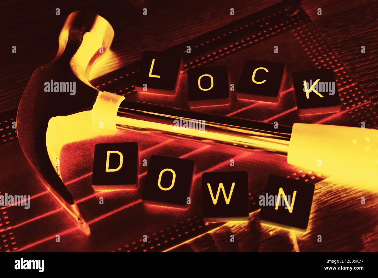 Hammer On Face Mask, Corona Lockdown Stock Photo