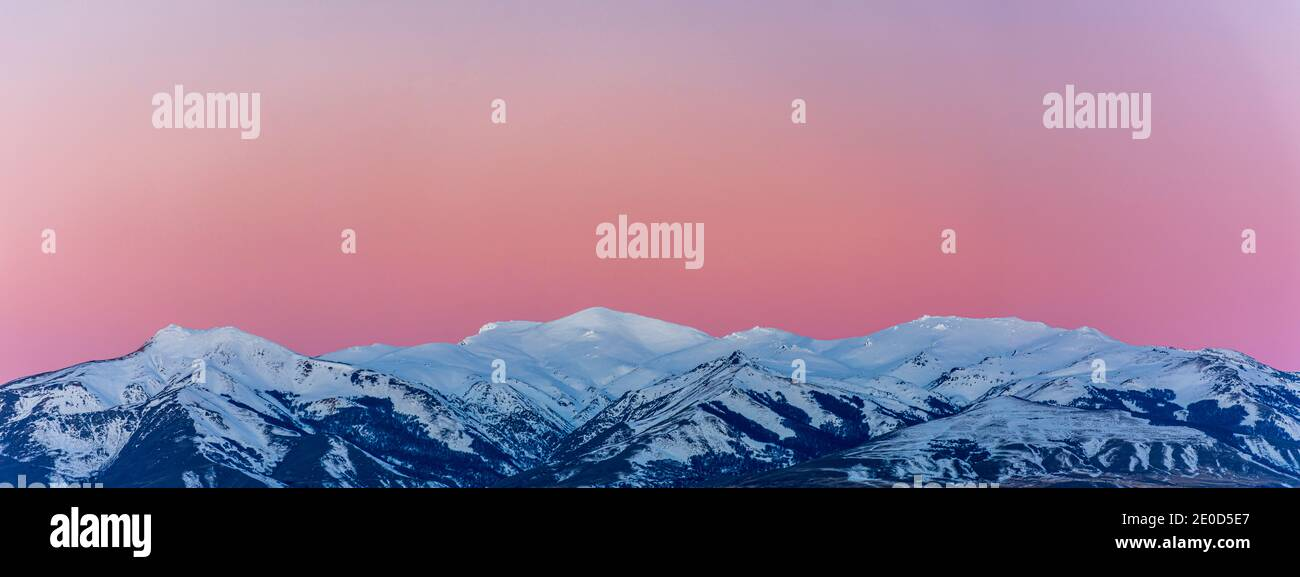 Scene view of snow covered mountains against beautiful pink sunset during winter season in Esquel, Patagonia, Argentina Stock Photo