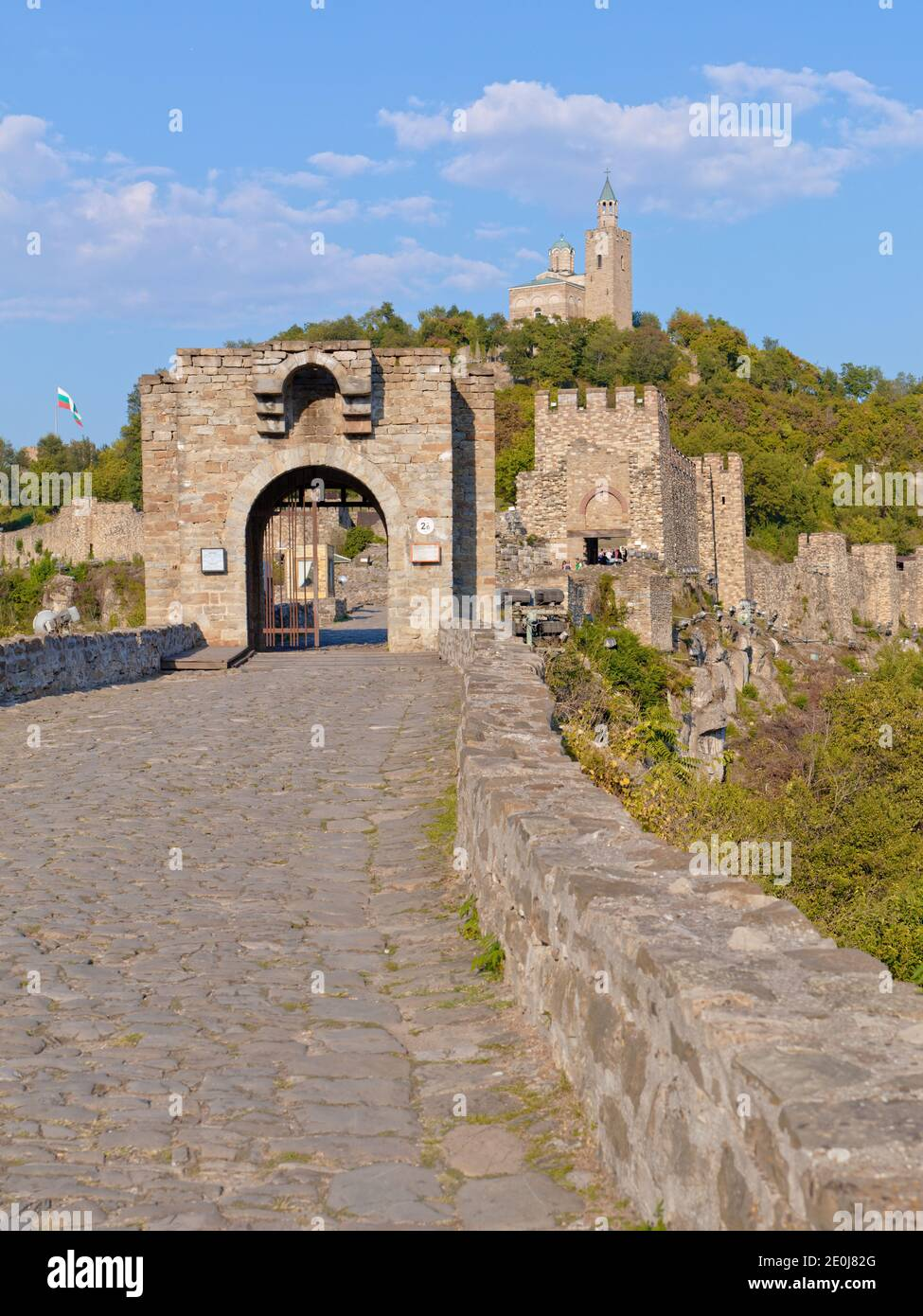 Main gate of Tsarevets fortress on the hill with same name in Veliko Tarnovo, Bulgaria. Patriarchal Cathedral of the Holy Ascension of the Lord on top Stock Photo