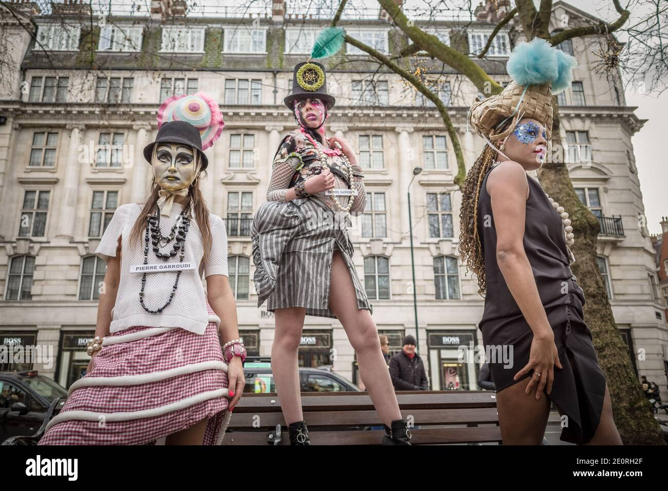 London, UK. 2nd January 2021. Models take part in a colourful flashmob street fashion show near Sloane Square for designer Pierre Garroudi. Credit: Guy Corbishley / Alamy Live News Stock Photo