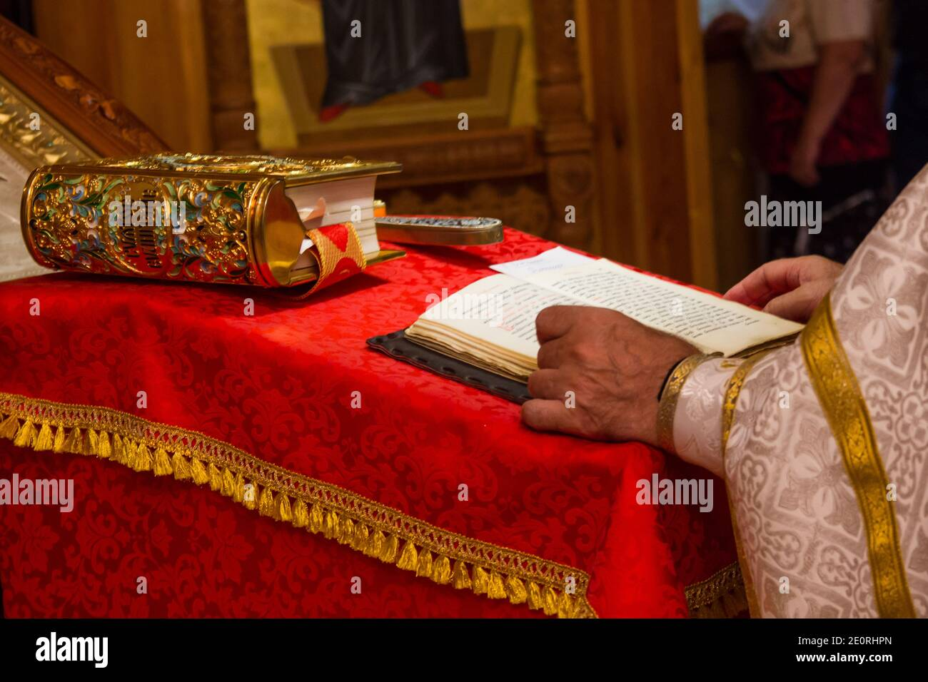 A priest holding the Bible at a christian ritual. Christian celebraton Stock Photo