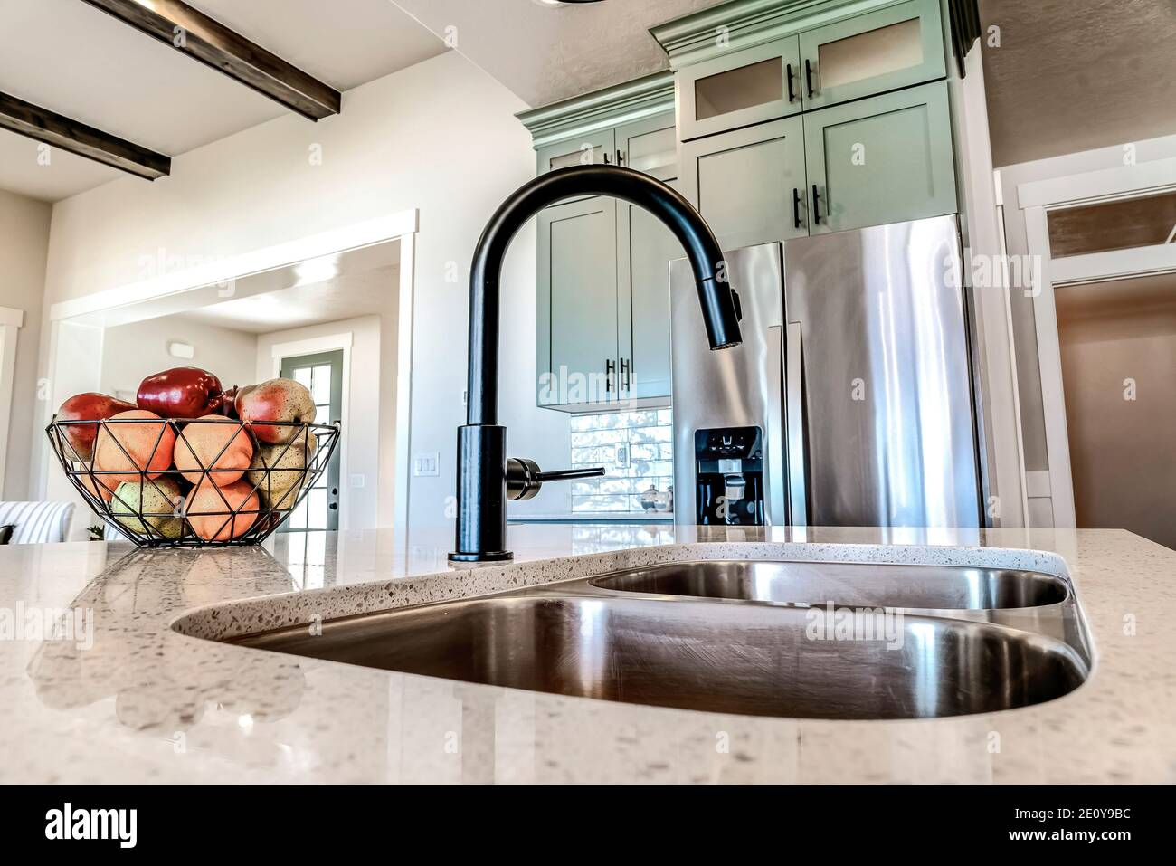 Kitchen Island With Black Faucet And Stainless Steel Sink Against Refrigerator Stock Photo Alamy