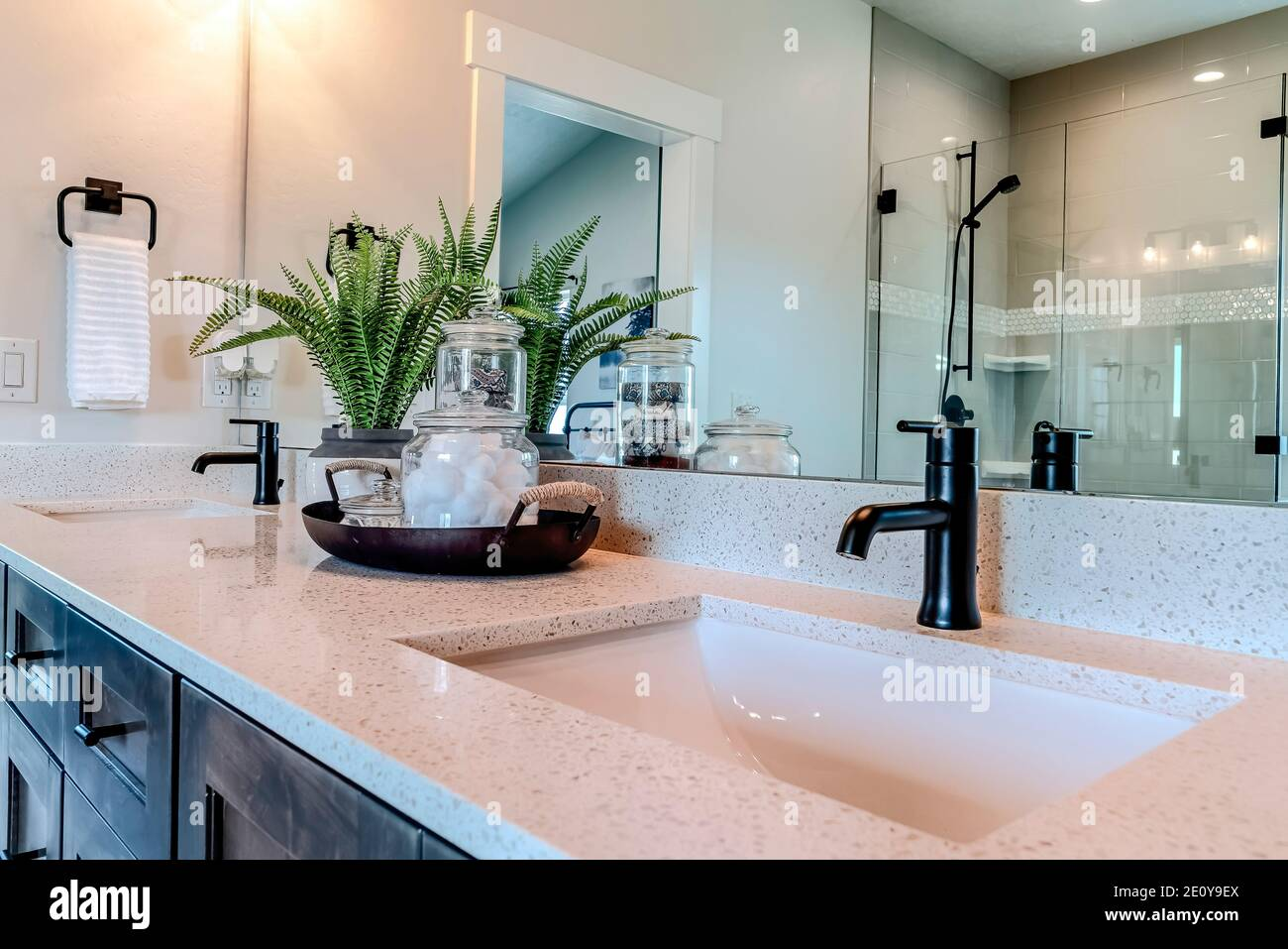 Double Sink Bathroom Vanity With Black Faucet And White Countertop Over Cabinets Stock Photo Alamy