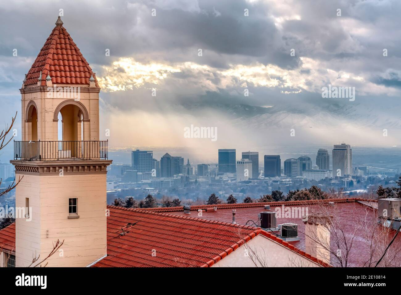 Bell tower and red rooftop of a church against foggy Salt Lake City landscape Stock Photo