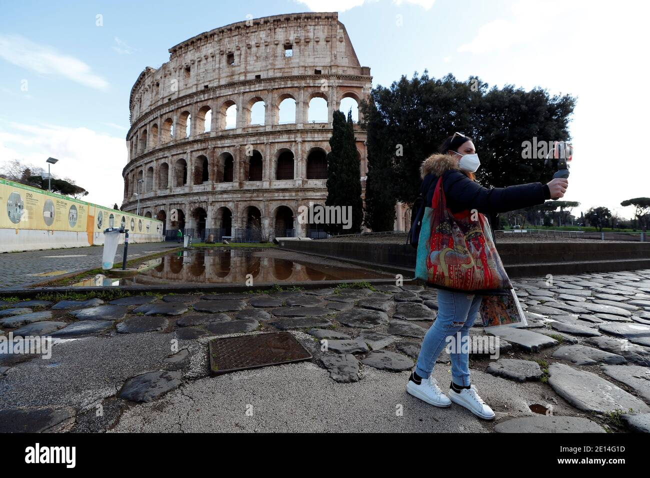 A tourist guide gives a virtual tour at the Colosseum, one day ...