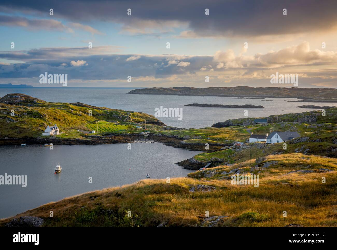 South Harris, Isle of Lewis and Harris, Scotland: Clearing evening storm clouds over an isolated coastal village Stock Photo