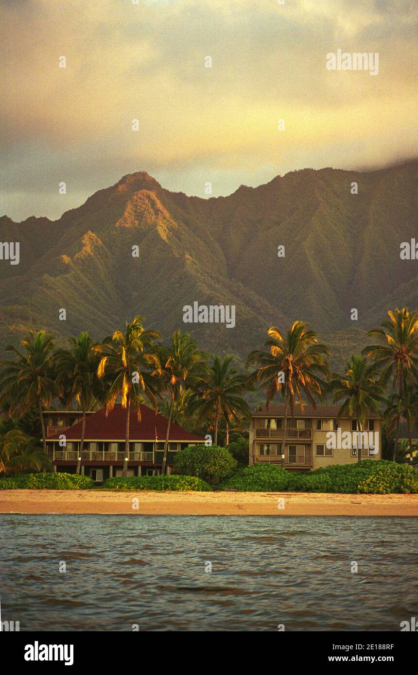 Beachfront vacation rental homes with Mt. Ka'ala in background, shot from sea, in afternoon light, at Waialua, on the North Shore of Oahu Stock Photo