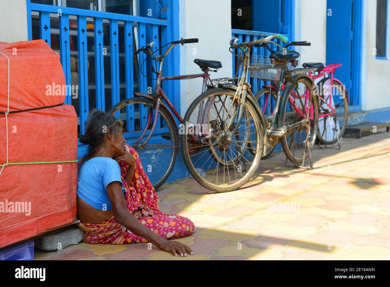 A beggar sitting outside the Indian coffee house in Pondicherry, India. Stock Photo
