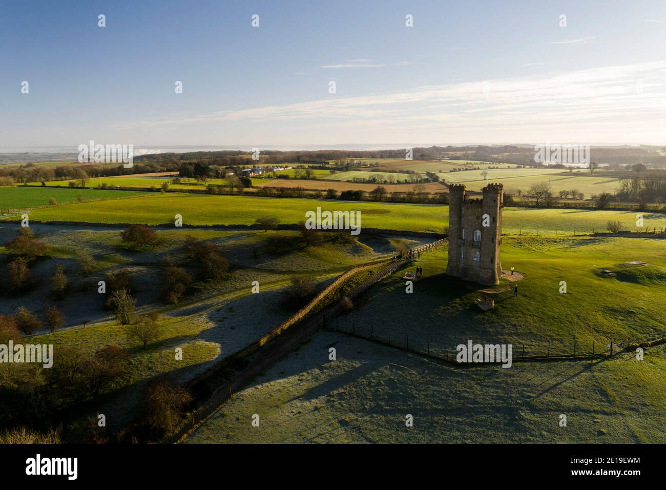 Aerial drone photo of Broadway Tower, a famous old building landmark in The Cotswolds Hills, iconic English tourist attraction in beautiful British countryside with green fields, Gloucestershire, England, UK Stock Photo