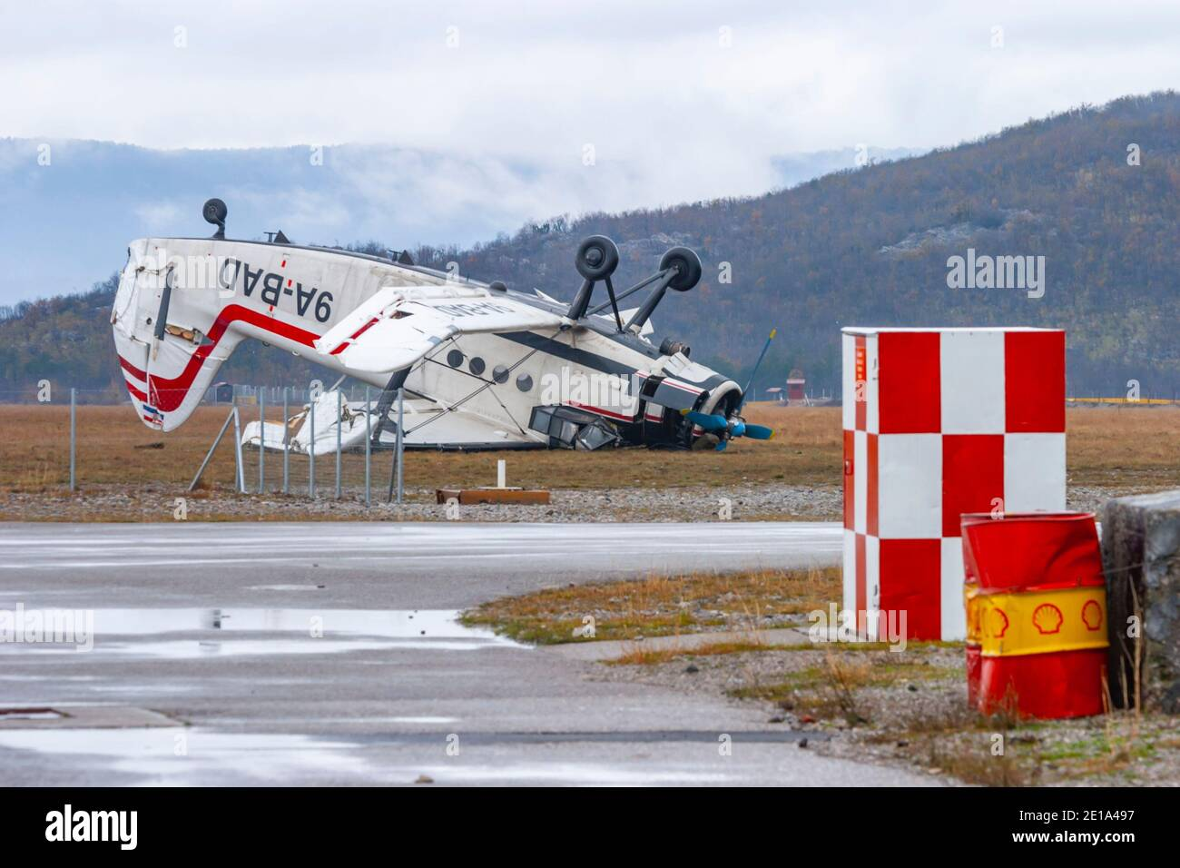 """Biplane aircraft crashed by very strong wind """"bura"""" ying inverted turned-over An-2 9A-BAD owned by Grobnik airport para-club on Nov. 23, 2005 Stock Photo"""