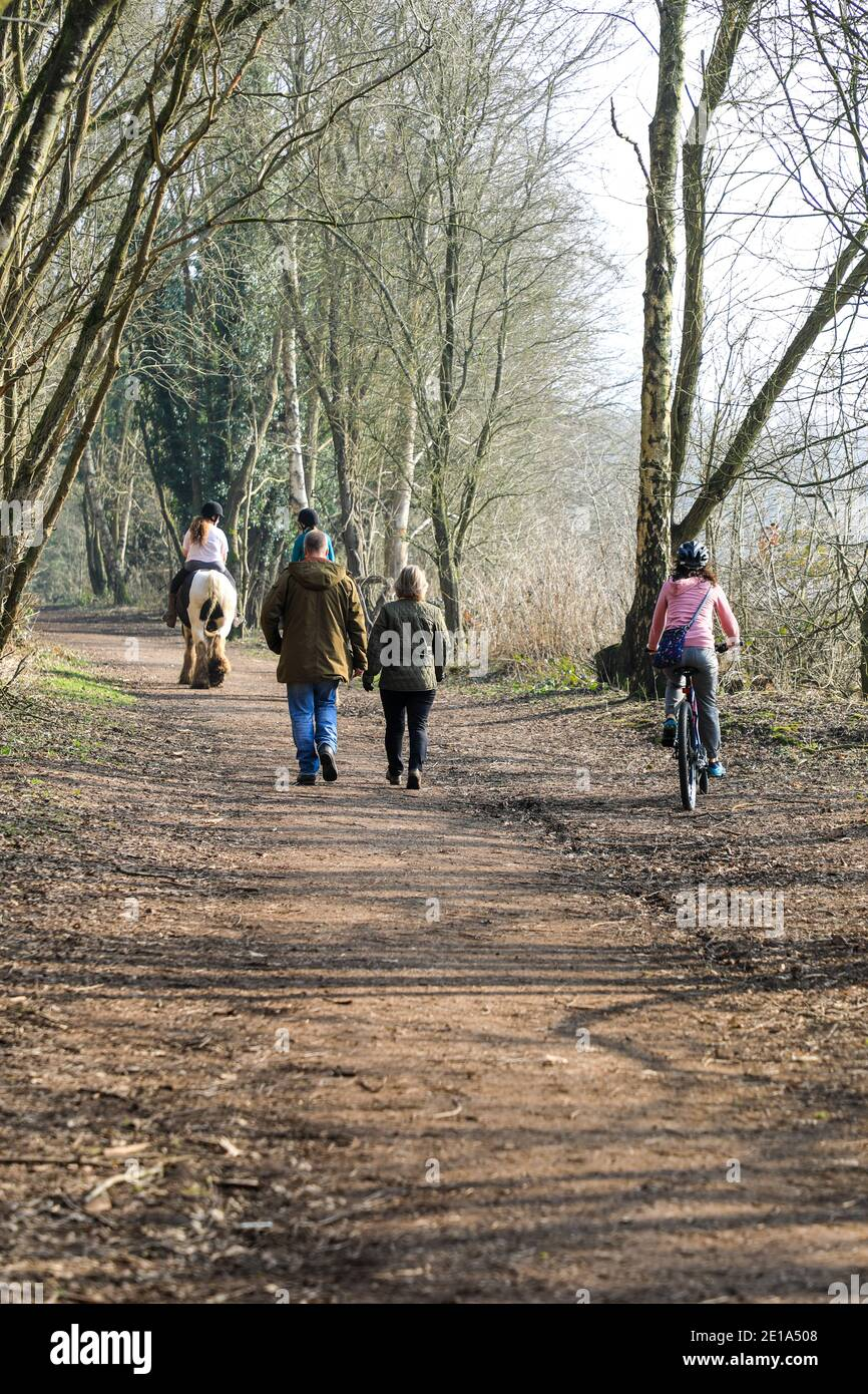 The conflict of horse riders, cyclists and walkers using the same path on the old Churnet railway line at Oakamoor, Staffordshire, England, UK Stock Photo