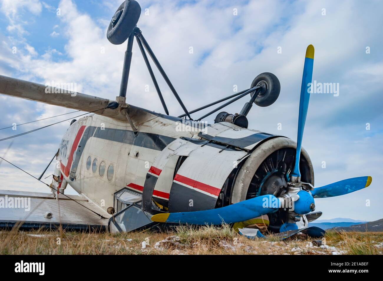 "Biplane aircraft mishap crashed by very strong wind ""bura"" lying inverted turned-over An-2 9A-BAD owned by Grobnik airport para-club on Nov. 23, 2005 Stock Photo"