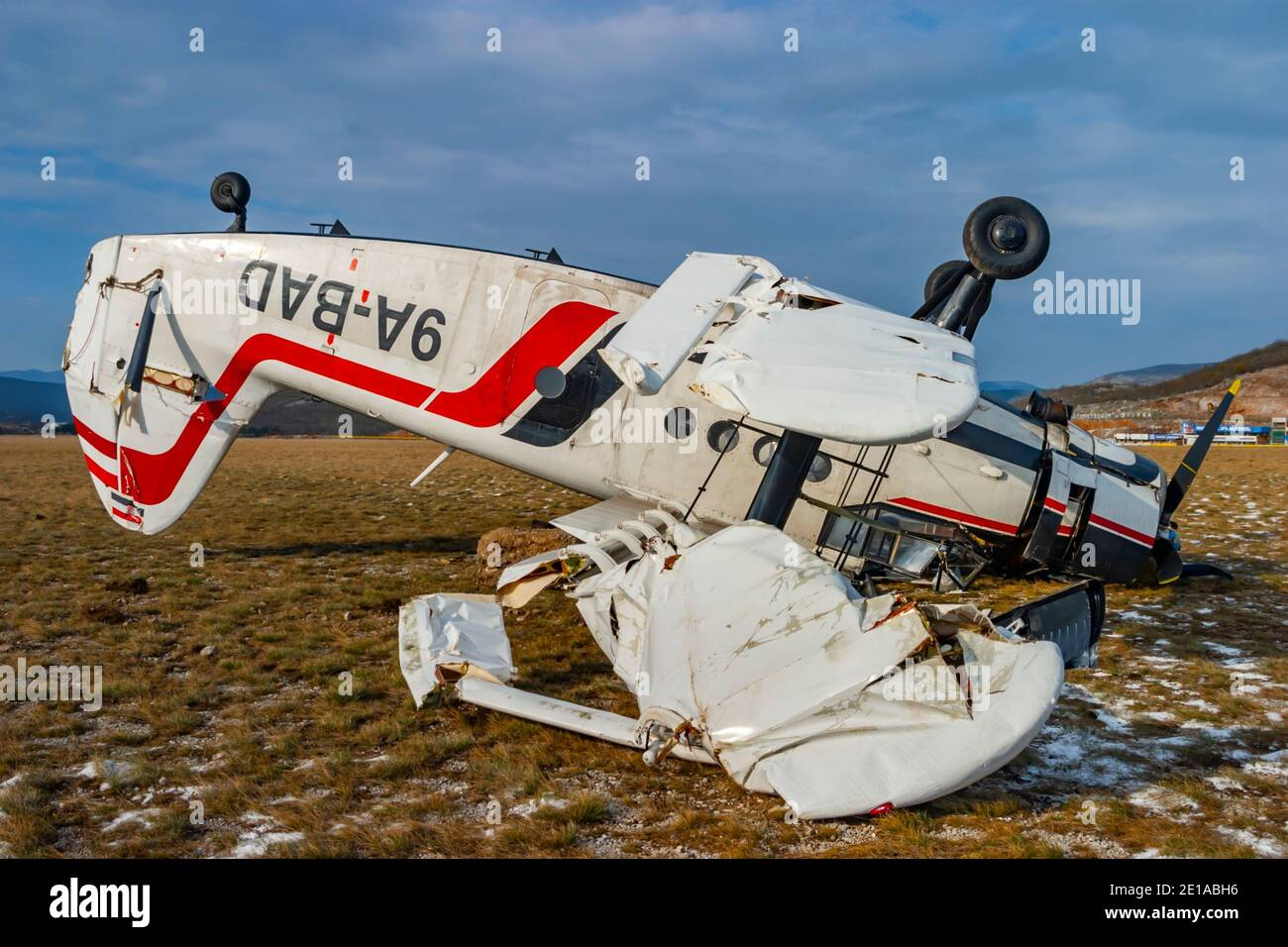 """Biplane aircraft mishap crashed by very strong wind """"bura"""" lying inverted turned-over An-2 9A-BAD owned by Grobnik airport para-club on Nov. 23, 2005 Stock Photo"""