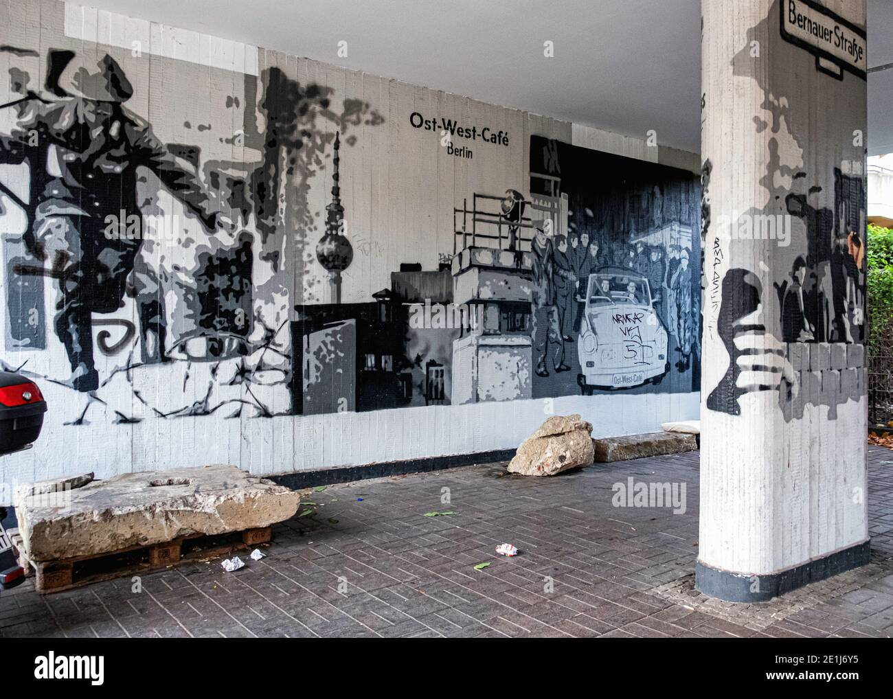 Parking garage of Ost-West-Cafe with black and white pictures of Berlin Wall history In Bernauer Strasse,Mitte,Berlin Stock Photo