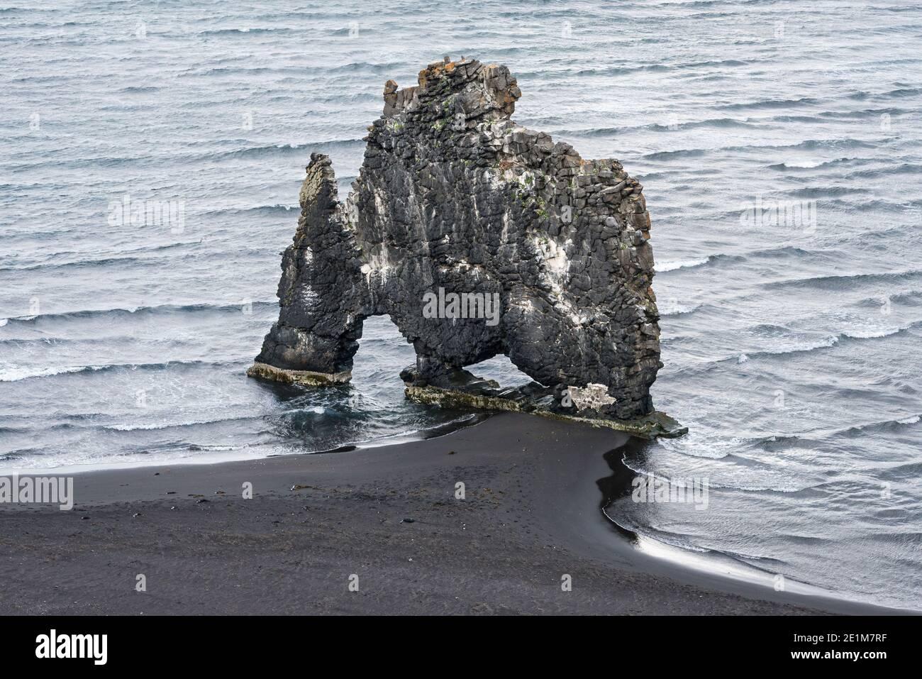 Hvítserkur, a 15m high basalt sea stack on the coast of the Vatnsnes peninsula (Iceland) shaped like a rhino, known as the Troll of Northwest Iceland Stock Photo