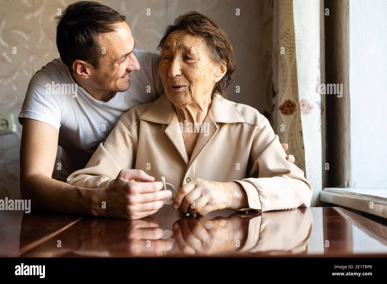 a very old woman and an adult grandson Stock Photo