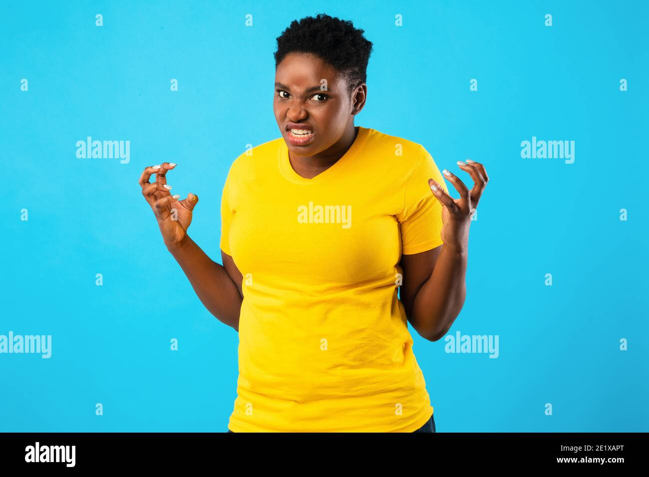 Mad African Woman Freaking Out Looking Angrily Posing, Blue Background Stock Photo