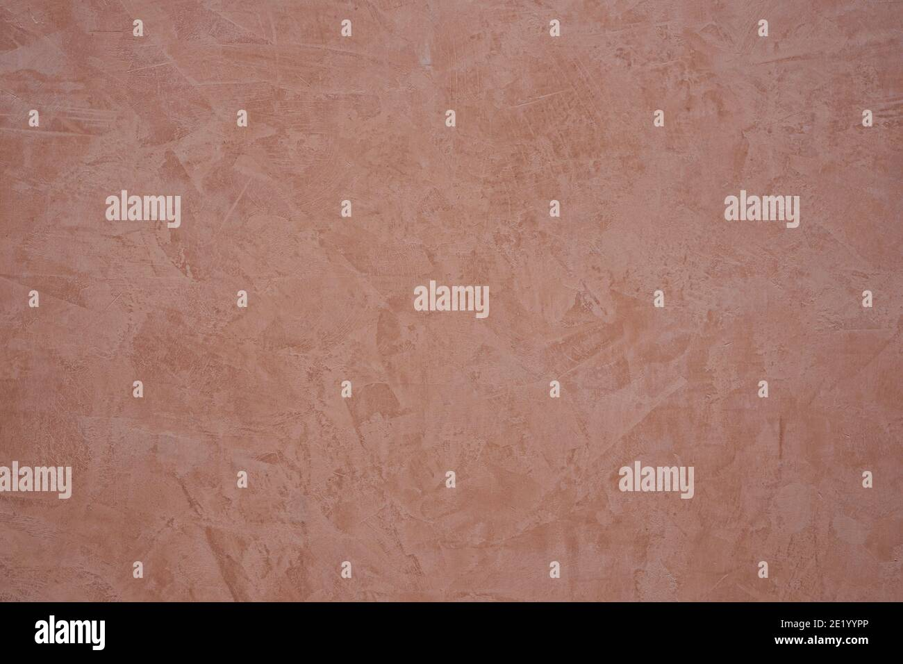 ochre colored stucco background with abstract drawings Stock Photo