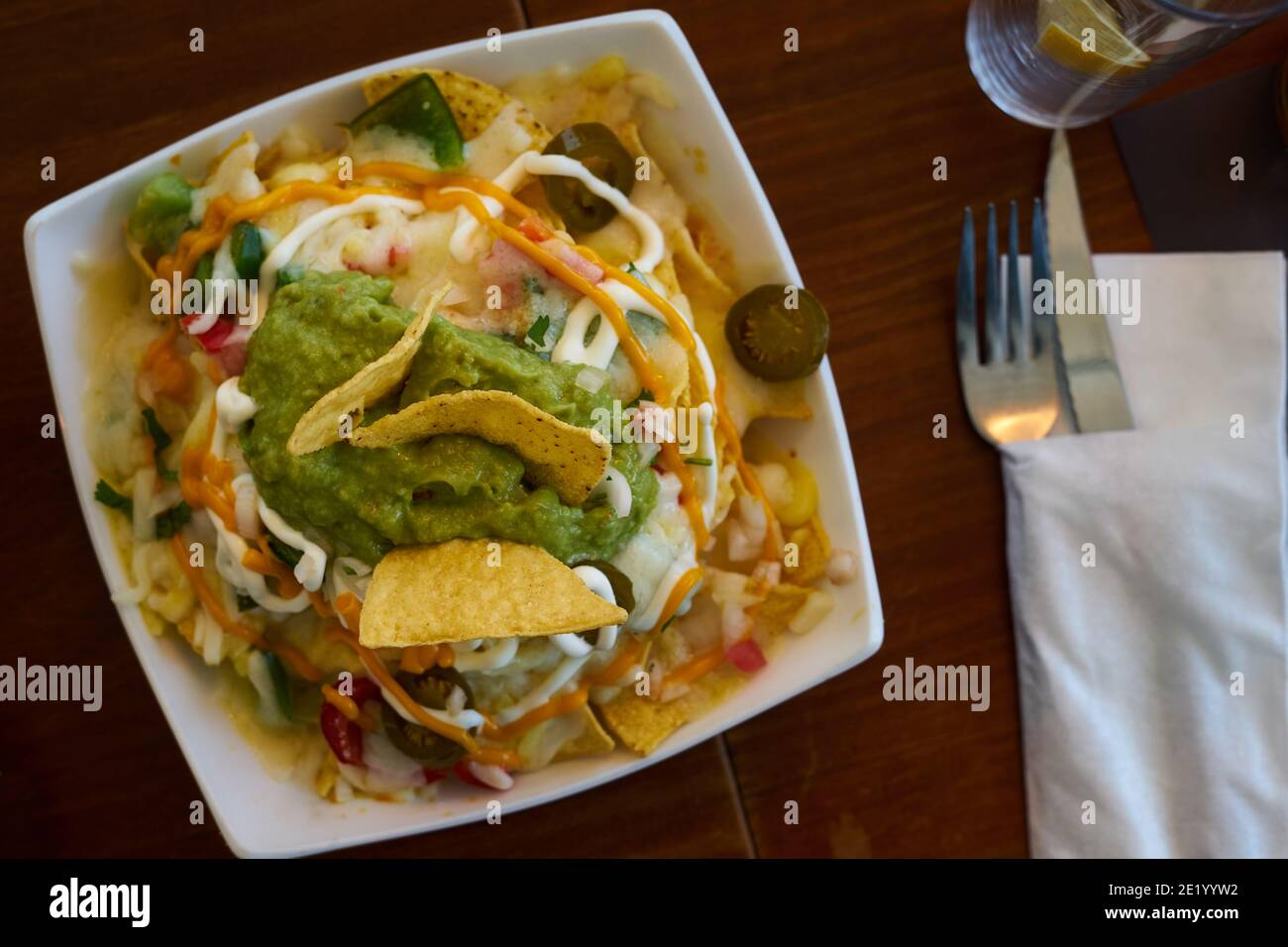 Mexican dish, nachos with cheese and vegetables, selective focus Stock Photo